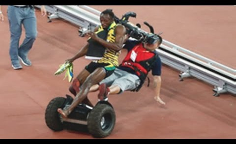 Usain Bolt Gets Taken Out By Cameraman On A Segway!