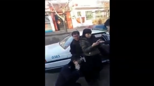 Damn-Chinese-Cop-Knocks-Woman-Out-With-A-Baton!